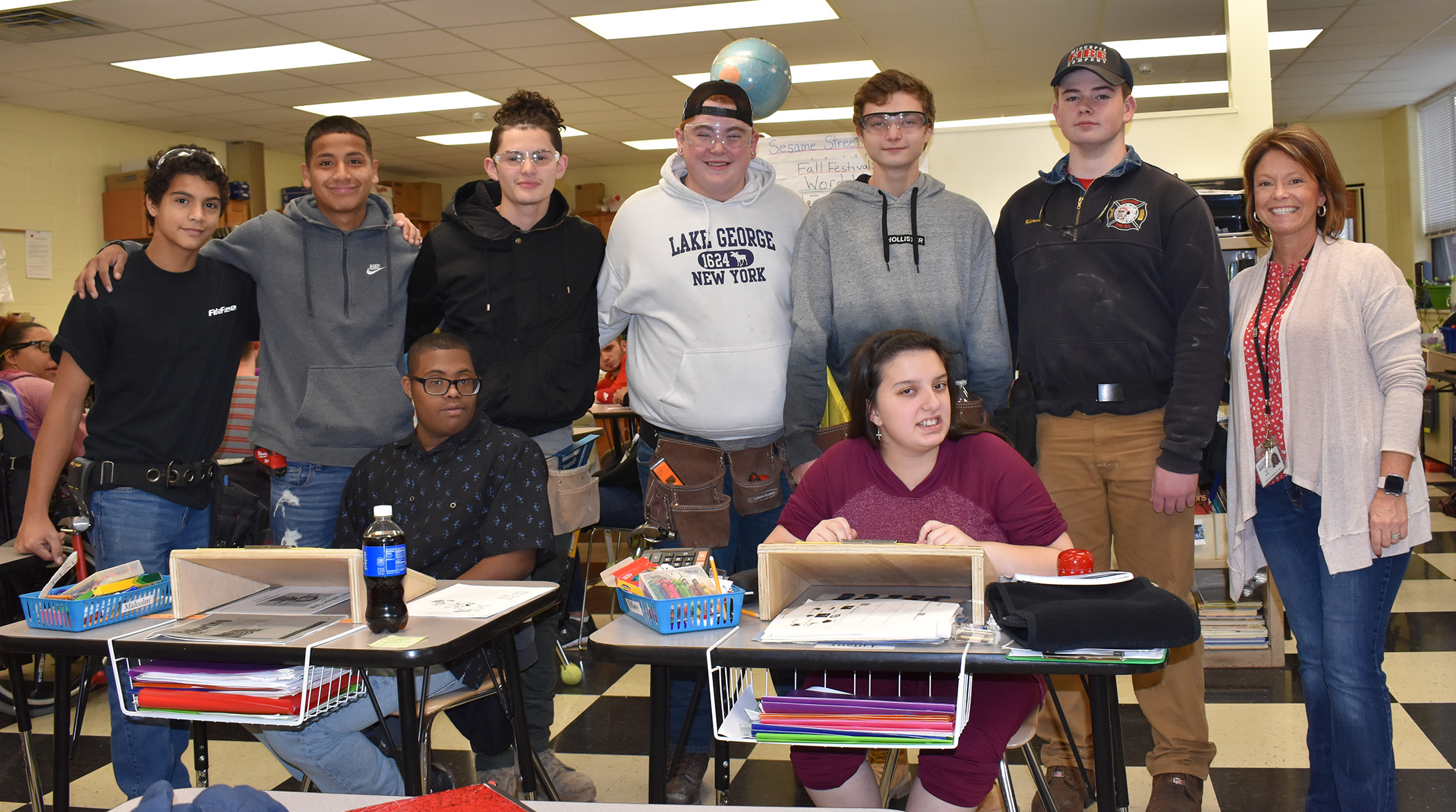 Pictured are Construction Trade students from the Dutchess BOCES Career and Technical Institute and students who use slant boards to improve writing along with occupational therapist Lisa Serlin