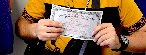 [PIC] Izhar Ramos' Hands Holding His High School Equivalency Diploma