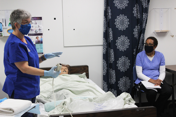 [PIC] Dutchess BOCES Adult Learning Institute Nursing Assistant Instructor Susan DeMan Demonstrates For One Of Her Nine Students