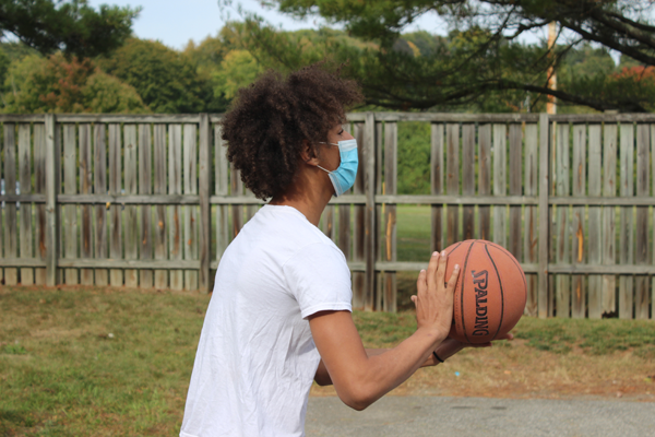 [PIC] Dutchess BOCES Alternative High School Student Wearing A Mask Prepares To Shoot A Basketball