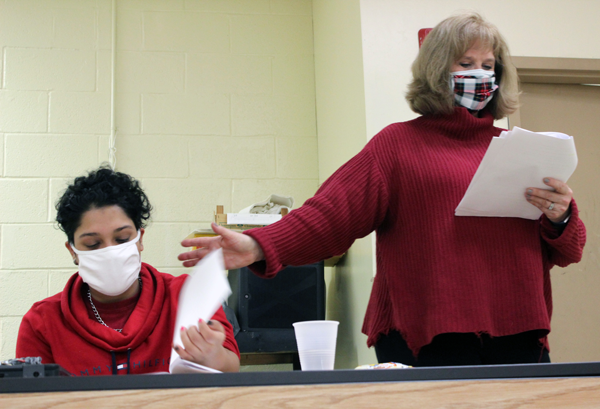 [PIC] Dance and Theater Instructor, Kathy Muenz, directs a student through a recording of a radio drama