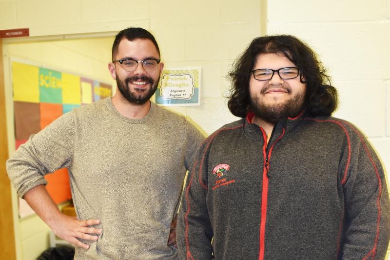 Teacher Patrick Miraglia stops for a photo with student William Sturdivant