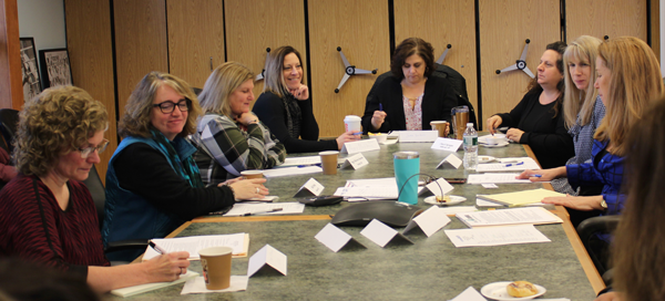 [PIC] School District Clerks Sitting At Board Room Table Together