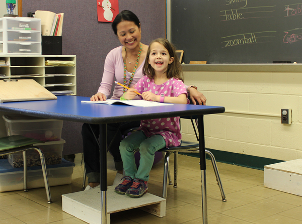 [PIC] Pegasus Program Occupational Therapsit Sitting And Working With A Young Student