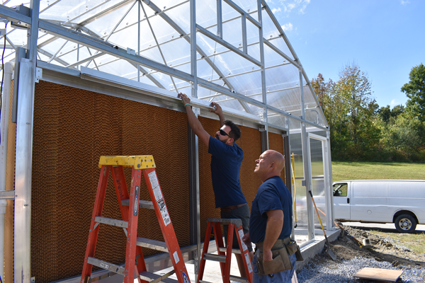 [PIC] Facilities & Operations Staff Work On Greenhouse Framework