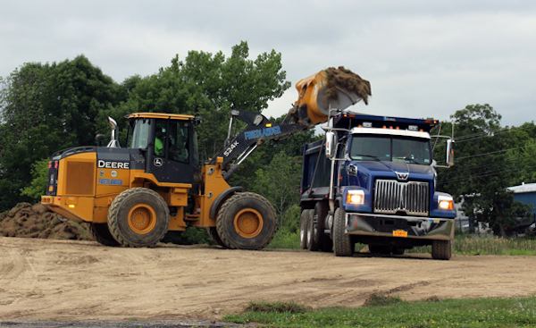 [PIC] Backhoe Dumps Soil Into Dump Truck As Part Of Dutchess BOCES Campus Capital Project