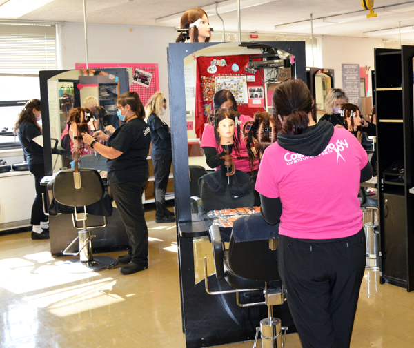 [PIC] Masked Career & Technical Institute Cosmetology Students Work Individually OnTheir Training Mannequins