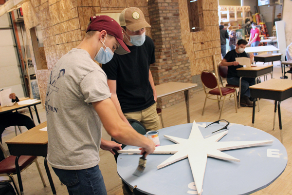 [PIC] Career Technical Institute Construction Trade Students Work On A Large Painted Compass