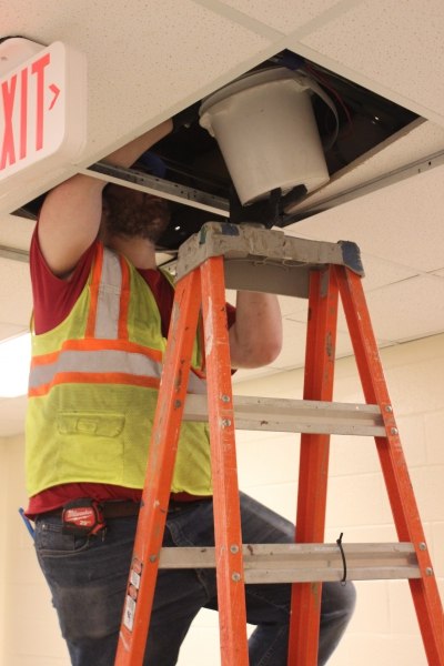 A worker removes water from the ceiling at Salt Point Center.