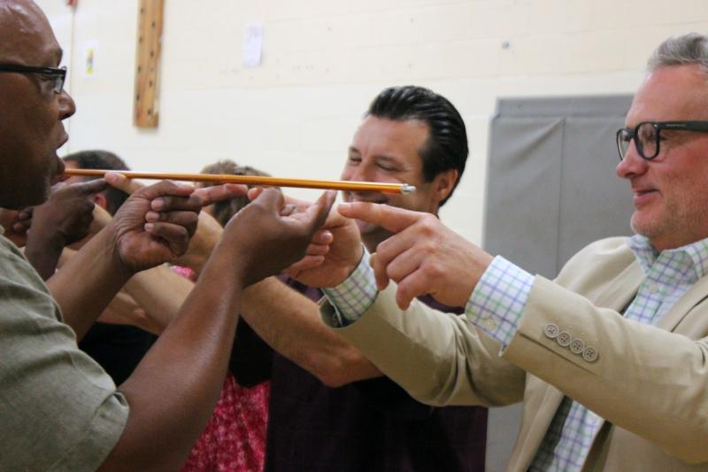 Incoming Superintendent Jason Schetelick (far right) participates in a team building exercise